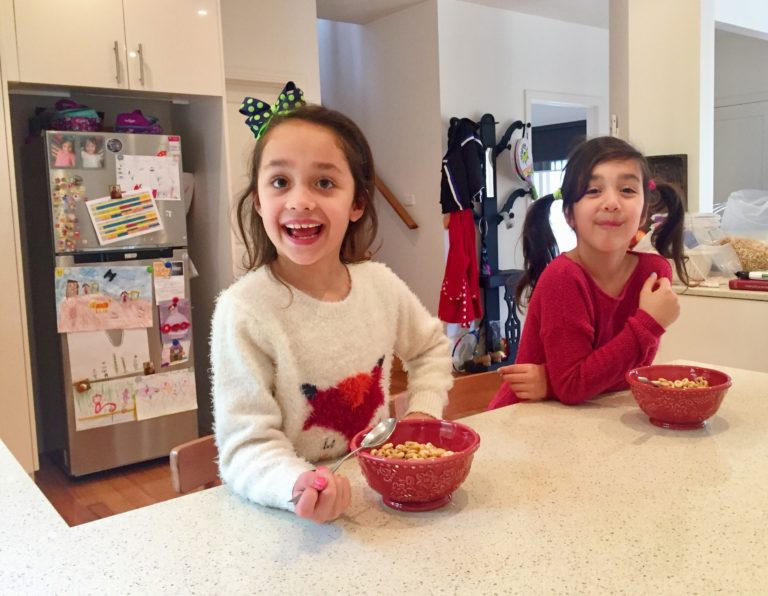Seven+year+old+twins%2C+Antonia+%28left%29+and+Iliana+%28right%29+eating+cereal+at+home.+Their+mother%2C+Vivian+Papadima%2C+is+concerned+about+what+goes+into+their+food.+Picture%3A+Sofia+Vamvakidou