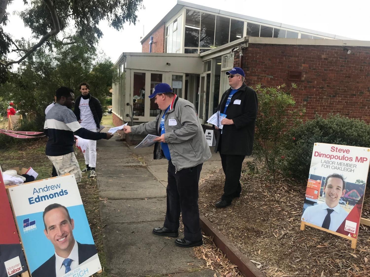 Volunteers at work outside the Monash Uniting Church polling booth in Clayton.