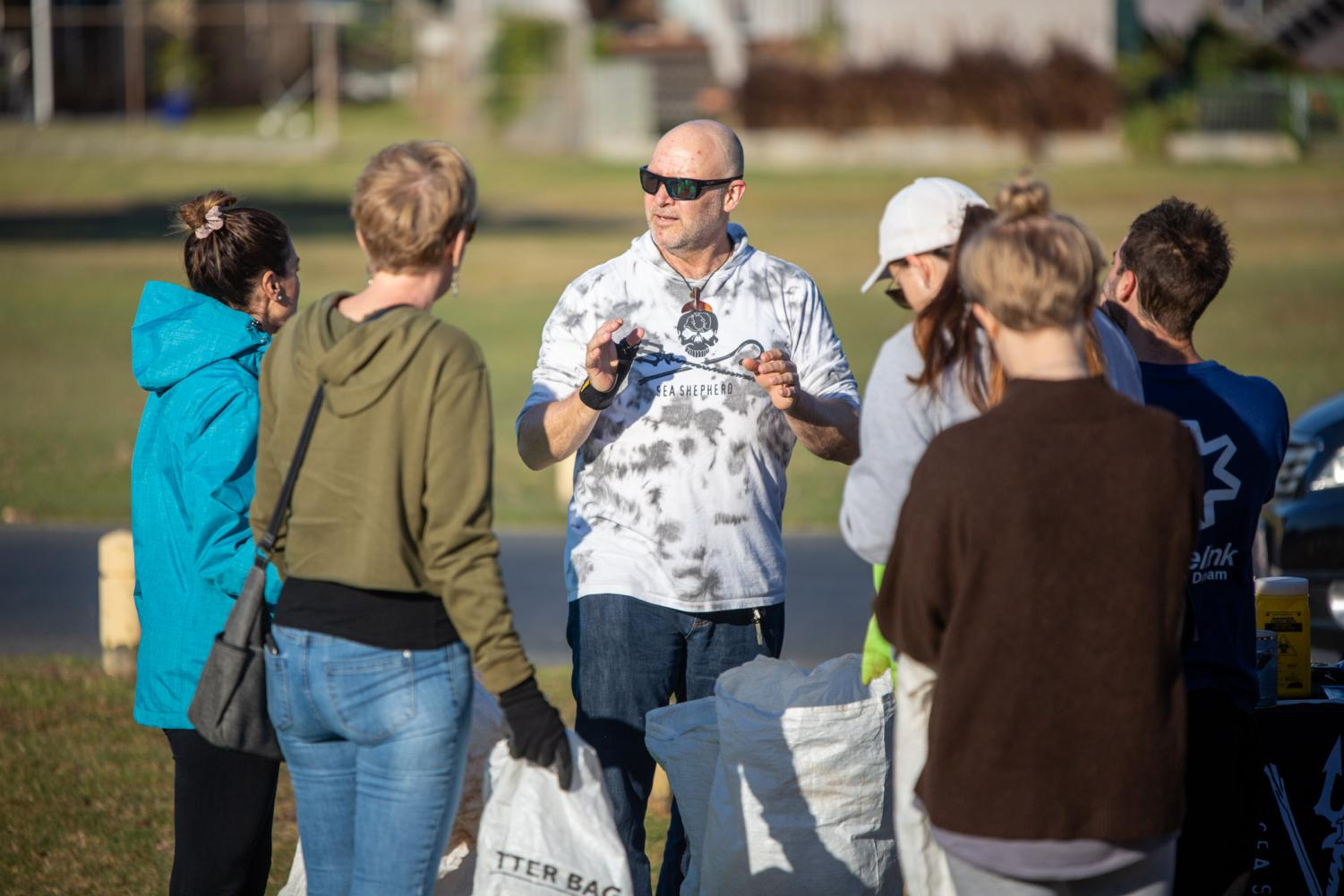 Sea Shepherd's Stuart Donald briefs a group of volunteers ahead of the Nudgee Beach clean-up
