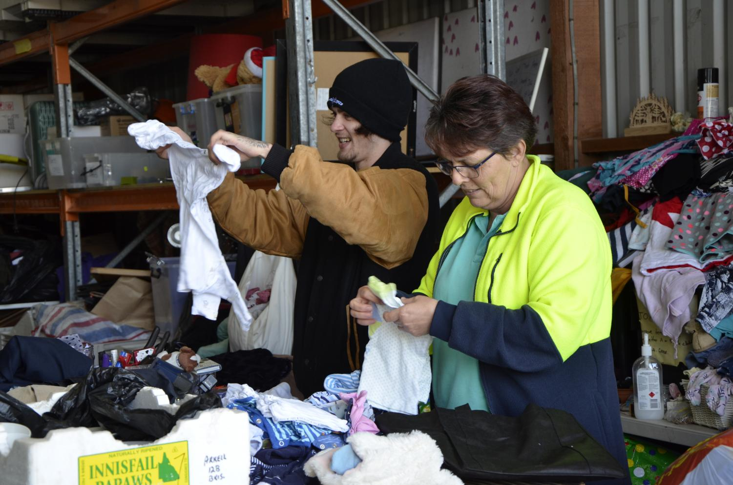 Asthma Foundation volunteers at the foundation's Coorparoo op shop sorting through donations to see what can be sold, what will be exported or what will go to landfill.
